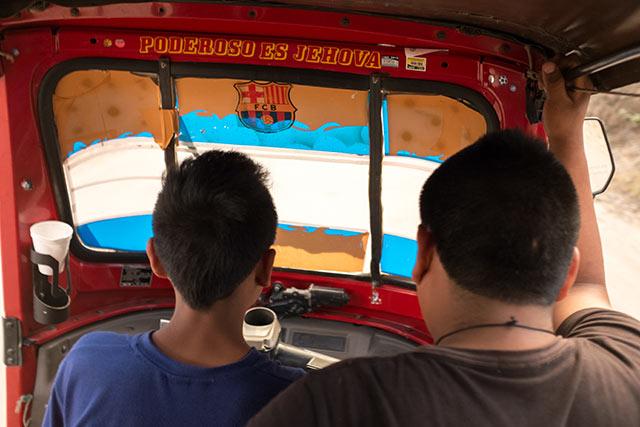 A way too young tuk-tuk driver practising