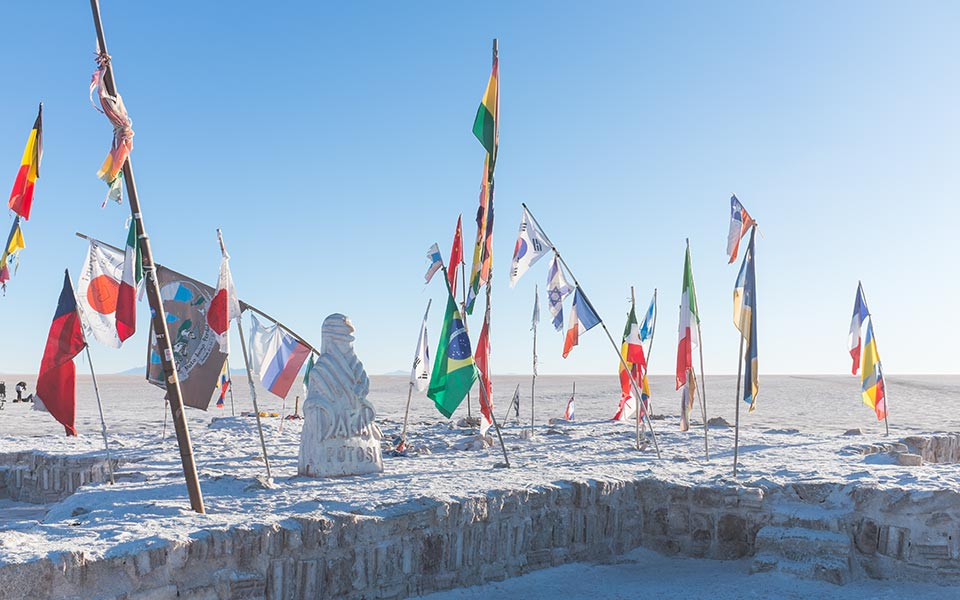 Flags from a previous edition of the Dakar race, Salar de Uyuni, Bolivia