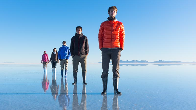 A bunch of people lining up, Salar de Uyuni, Bolivia